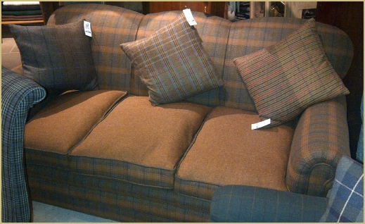 Magnificent three seater sofa covered in a Pure New Wool twist Saxony with contrasting milled Shetland cushions